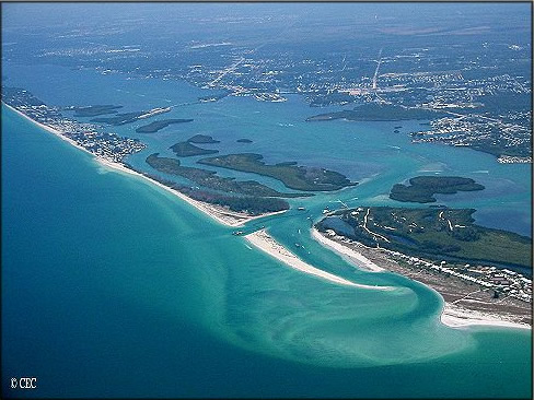 Aerial view of Manasota Key showing islands with beaches, main land and ocean